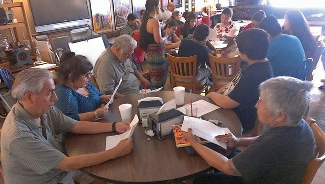 Students meet for a Mexican-American studies lesson at a cafe in Texas.