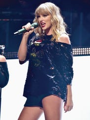 Taylor Swift performs onstage at the Z100's Jingle