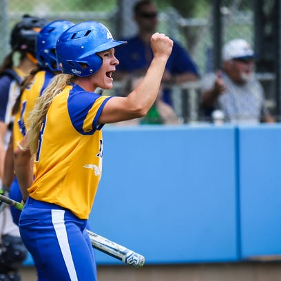 Angelo State's Danae Bina cheers on her teammates against