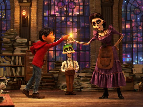 Miguel (voiced by Anthony Gonzalez, left) receives