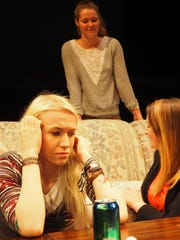 Laney, left front, played by Kylie Lorraine, grimmaces as her mother Elsie, played by Mackenzie Halfman, gives a talk about relationships to her and her friend Maribel, played by Cierra Glaeser.