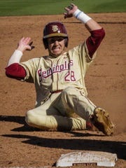 Florida State junior outfielder Dylan Busby slides