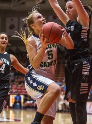Snow Canyon's Shaylee Reed drives towards the basket during the game against Pine View in Friday's 3A semifinal matchup at the SUU Centrum, Feb. 26, 2016.
