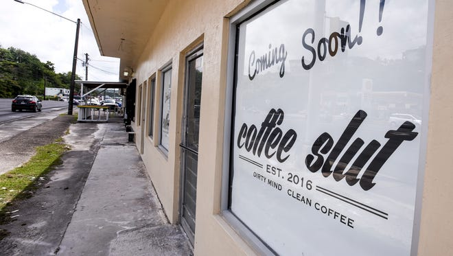 Signage in a window advertises the upcoming location of a new coffee specialty store in East Hagåtña on Tuesday, May 16, 2017.