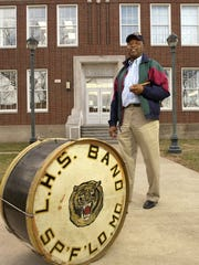 Homer Boyd has the bass drum and his drumsticks that