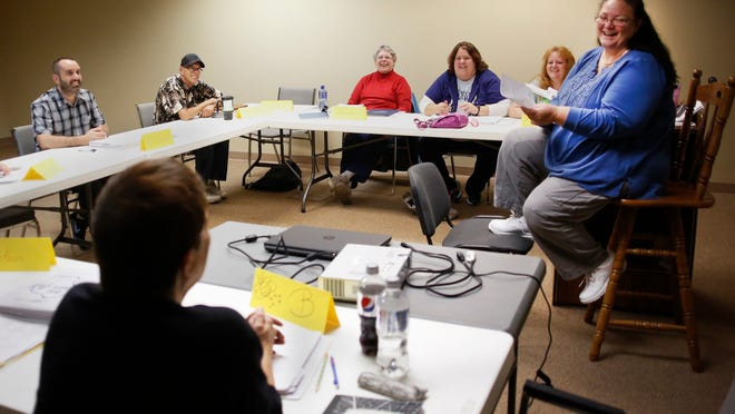 Peer specialist Paula Verrett (right) leads a class in a downstairs room in the NAMI office on Wednesday in Appleton.