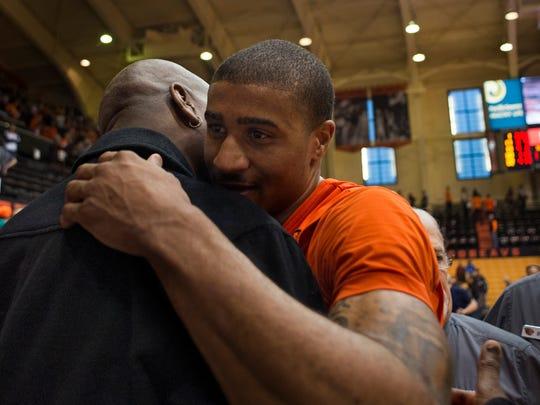 Jan 24, 2015; Corvallis, OR, USA; Oregon State Beavers guard Gary Payton II (right) hugs his dad, Gary Payton, after defeating the USC Trojans 59-55 at Gill Coliseum. Mandatory Credit: Godofredo Vasquez-USA TODAY Sports