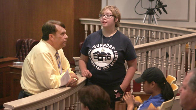 Dover Mayor Robin Christiansen talks to one of the homeless advocates who attended the open forum before a recent City Council meeting.