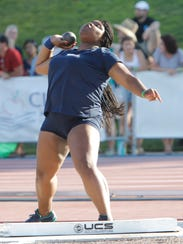 Denae Jackson of Redwood heaves the shot put at the CIF Track and Field Championships at Buchanan High School Saturday, June 2, 2018 in Clovis, Calif.