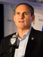 Pac-12 commissioner Larry Scott addresses the media