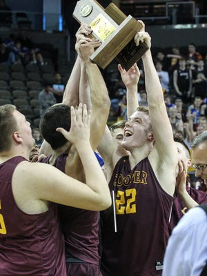 Sean McNeil and other Cooper players hoist the championship trophy following their 51-38 win over CovCath in the Boys' Ninth Region Basketball Tournament championship game at NKU's BB&T Arena, Monday, March 6, 2017.