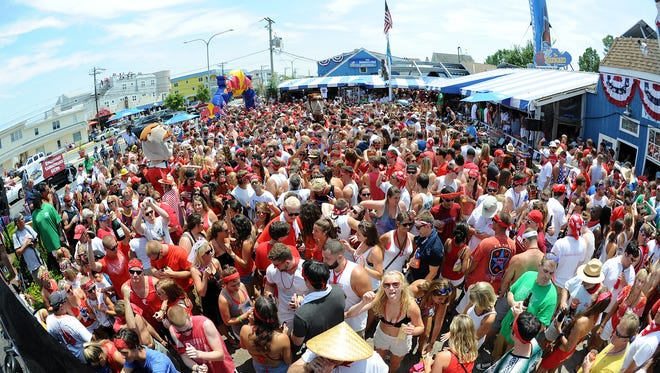 """The annual Running of the Bull is held in Dewey Beach at the Starboard. A """"Bull"""" chases partiers  down the beach and they end at a local bar for libations and live entertainment."""