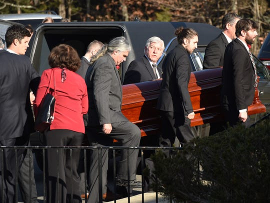 Retired Rep. Maurice Hinchey's casket is brought into