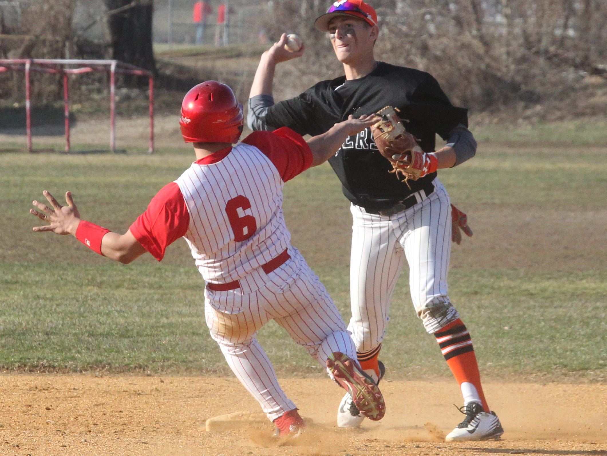 Mamaroneck's Anthony Pecora forces out North Rockland's Julio Rebolledo and throws to first for a double play during their game at North Rockland Apr. 6, 2015. Mamaroneck won 3-2.