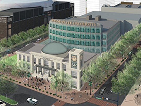 "The Ilitch family plans to donate $35 million to build Wayne State's new business school plus a $5-million endowment. The building, seen here in an artist's rendering of an aerial view, would be marketed as ""Detroit's business school"" and located on property owned by the family and near the new Red Wings arena under construction on Woodward Avenue north of downtown Detroit."