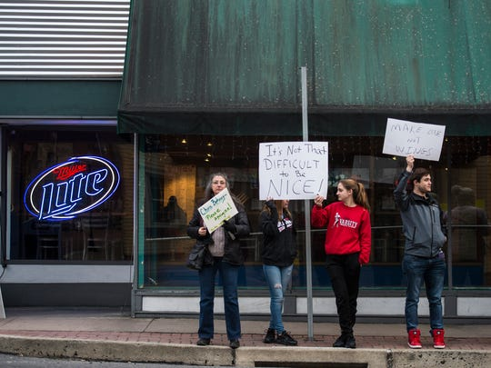 A group of 15 people protested outside of Just Wing It in Annville on Sunday, Feb. 5, 2016 demanding Chris Behney, founder of Just Wing It, issue an apology after using a racial slur against an African American Lebanon Valley College student on Sunday, Jan. 22, 2016.