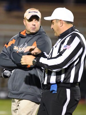 Barnegat High School Coach Rob Davis talking to a referee during a football game last fall.