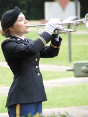Jordan Allen playing Taps at a Veteran's Day ceremony in 2014.