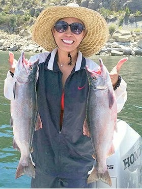 Mely Johnston of Gallup caught these 3.5 pound kokanee salmon on a pink spoon while fishing on Navajo Lake on July 31.