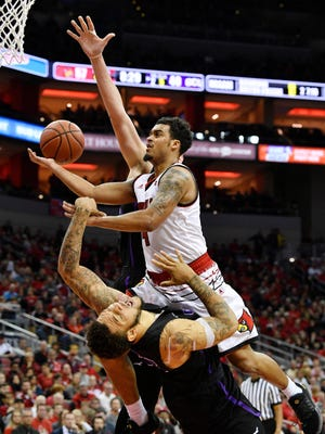 Dec 23, 2017; Louisville, KY, USA; Louisville Cardinals guard Quentin Snider (4) draws a foul while shooting against Grand Canyon Lopes forward Keonta Vernan (24) during the second half at KFC Yum! Center. Louisville defeated Grand Canyon 74-56.  Mandatory Credit: Jamie Rhodes-USA TODAY Sports