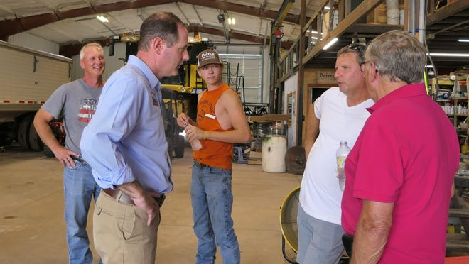Tracey Mann speaks with constituents at a farm in Hutchinson, Kansas.