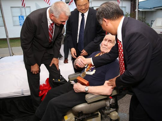 In September 2015, Richard Sherman, a Flying Tigers pilot, was congratulated by, from left, U.S. Rep. Ralph Abraham; Wang Jinshu, chairman of Shandong Yuhuang Chemical Co. Ltd.; and Chinese Consul General Li Qiangmin.