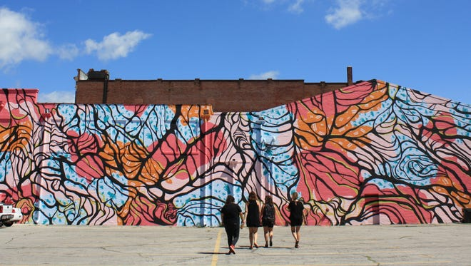 The new mural on the side of the Mark III Tap Room in downtown Muncie was the work of the We're Trying Collective, made up of JoAnna Darda, Braydee Euliss, Faith Kellermeyerand Jannell Summers