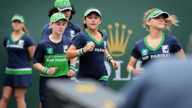 Ball kids deploy on Stadium 1 at the Indian Wells Tennis Garden on the first Wednesday of the BNP Paribas Open on March 7, 2018 in Indian Wells, CA.