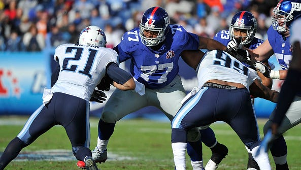 Former Ole Miss offensive lineman John Jerry (77) blocks two members of the Tennessee Titans during their game in 2014. Jerry figures to be the Giants' starting right guard this season, one he hopes will be a big one for him.