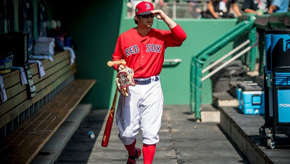 Andrew Benintendi of the Boston Red Sox looks on before a game against the New York Mets on February 24, 2017 at Fenway South in Fort Myers, Florida.