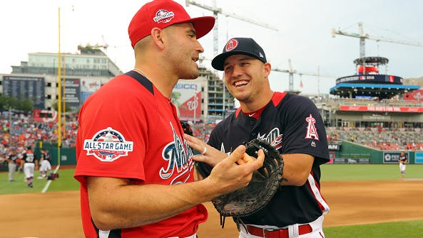 Joey Votto (left) of the Cincinnati Reds jokes with Mike Trout of the Los Angeles Angels prior to the T-Mobile Home Run Derby at Nationals Park on Monday, July 16, 2018 in Washington, D.C.