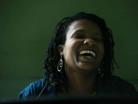June Pressley smiles as she plays the piano in one