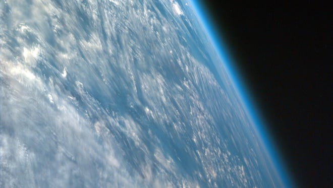 This image of Earth from the International Space Station captures the curvature of the Earth and shows its thin atmosphere. Levels of carbon dioxide in the atmosphere reached a milestone level of 400 parts per million in March 2015, NOAA reported.