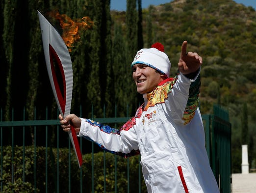 Washington Capitals star Alex Ovechkin got his wish and had a chance to carry the Olympic torch on Sunday in Greece in advance of the Sochi Games in February.