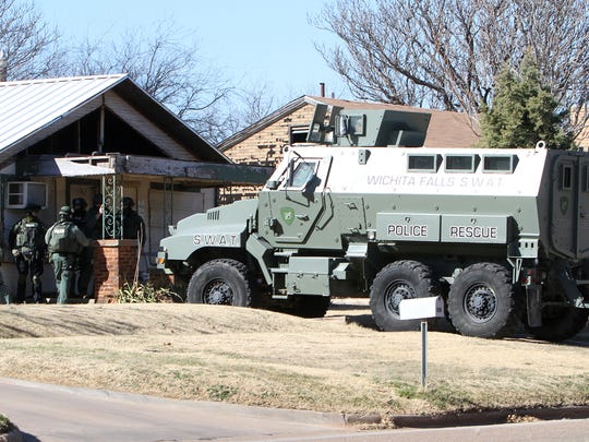 Members of theWichita Falls Police SWAT team hold their