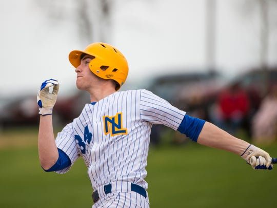 Northern Lebanon's Michigan Daub watches the ball sail over the fence for a three-run home run as Northern Lebanon beat Lebanon Catholic 11-0 in five innings on Thursday, April 13, 2017.