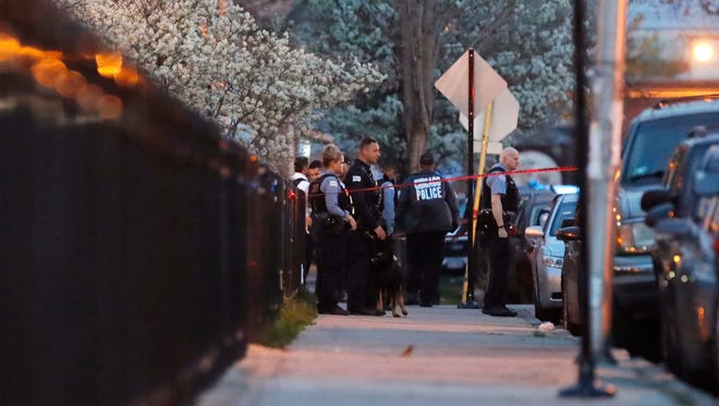 Chicago police work the scene near the area where a federal agent was shot and critically wounded in Chicago while working on an investigation with local authorities on May 4.