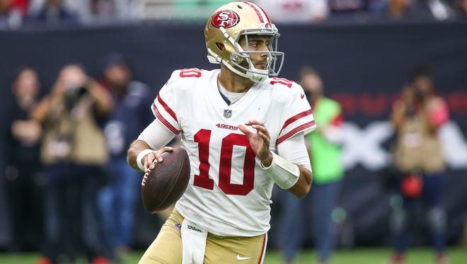 San Francisco 49ers quarterback Jimmy Garoppolo runs with the ball during the fourth quarter against the Houston Texans at NRG Stadium.