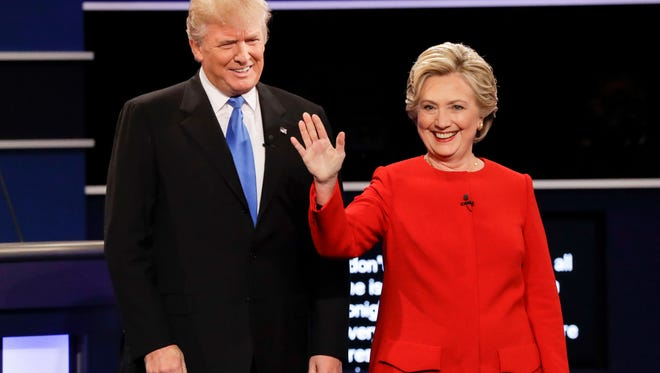 Republican presidential nominee Donald Trump and Democratic presidential nominee Hillary Clinton are introduced during the presidential debate at Hofstra University in Hempstead, New York.