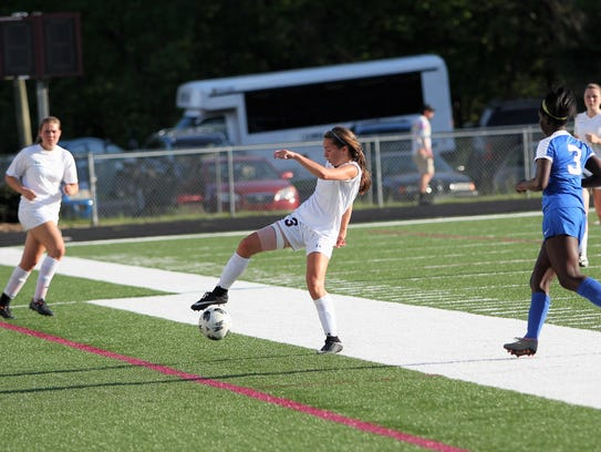 Owen sophomore Camryn Bolick controls the ball in a 4-0 win over Maiden to open the playoffs May 9.