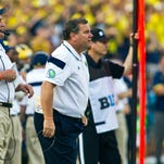 Brady Hoke watches Saturday's 30-14 loss. Hoke's Wolverines must begin beating second-tier teams, such as Utah and Minnesota, or the coach is liable to lose the confidence of program directors.