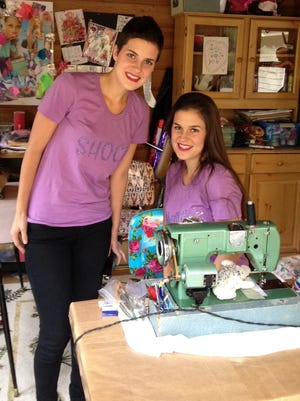 Grand Ledge twins Shawn (left) and Claire Buitendorp in 2012 in the sunroom of their family home.
