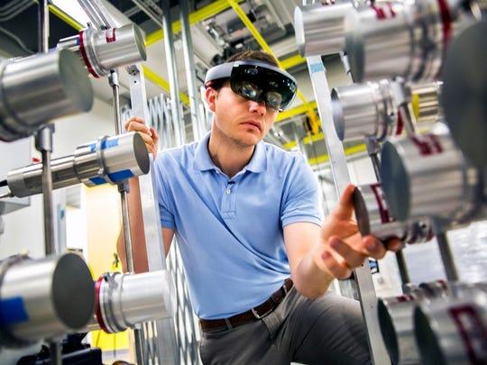 Michael Hamel, NERS Ph.D. Student, uses a Microsoft