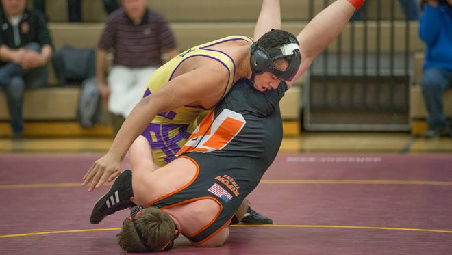 Dalton Becker (Two Rivers) battles with Hut Amend (Ripon) in the 160 weight class. Omro High School hosted the WIAA Team Wrestling Sectional. The Division 2, Sectional B included wrestlers from Ripon, Two Rivers, Oconto Falls and Wittenberg-Birnamwood.
