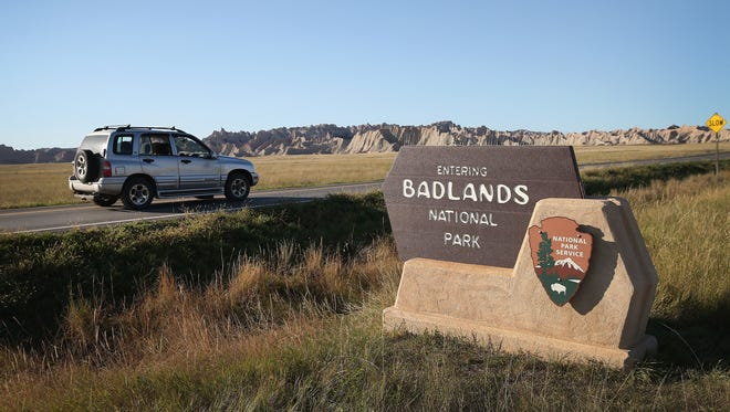 Visitors drive into the Badlands National Park on October 1, 2013 near Wall, South Dakota.