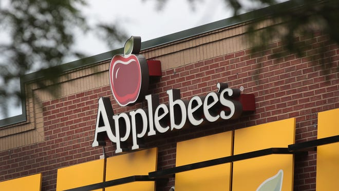 An Applebee's restaurant serves customers on August 10, 2017 in Chicago, Illinois. DineEquity, the parent company of Applebee's and IHOP, plans to close up to 160 restaurants in the first quarter of 2018. The announcement helped the stock climb more than 4 percent today.