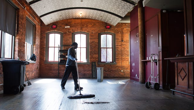 James Holmes sweeps the floor of an empty Brazwell's Premium Pub on Thursday, November 2, 2017.