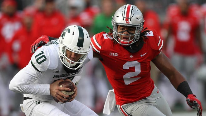 Michigan State's Messiah deWeaver is sacked by Ohio State's Chase Young during the fourth quarter Nov. 11, 2017 at Ohio Stadium in Columbus, Ohio.