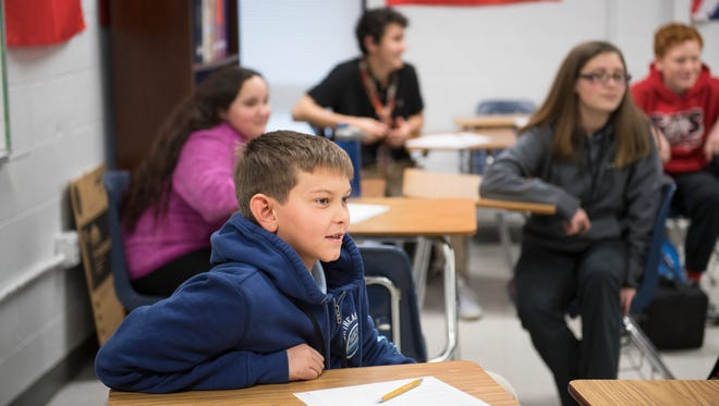 Seventh grader Cameron Billingsley watches as students perform a role playing exercise about communication in the workplace at Bryson Middle School in Simpsonville on Tuesday, February 13, 2018.