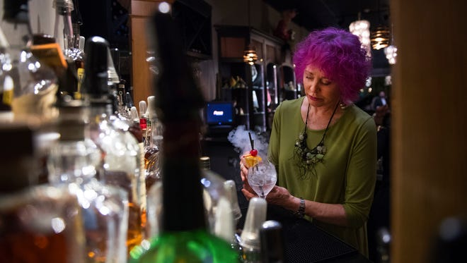 Betty Bercowski, owner of Rainer's Cafe and Bar, makes sangria using liquid nitrogen on Thursday, March 29, 2018.
